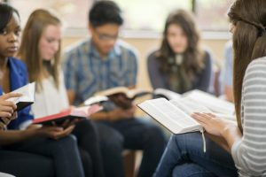 teens studying the Bible.